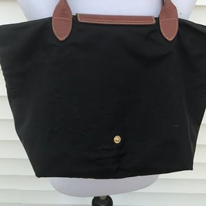 Longchamp Bags - Longchamps black tote it has pucker marks.
